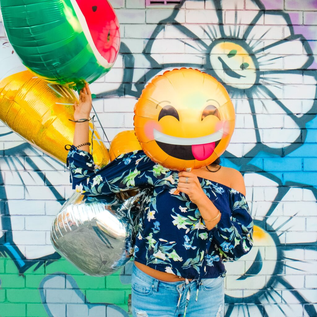 Person with balloon face laughing at comedy skits