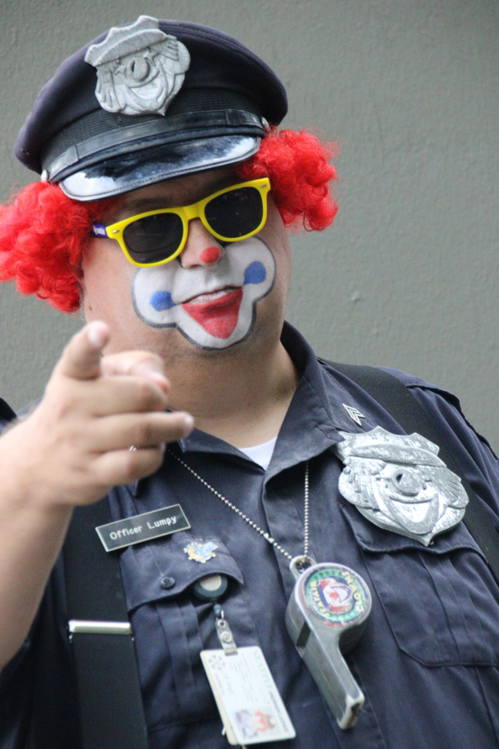 Clown face cop points at church comedy drama